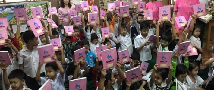 Donation of books and fed chicken rice porridge for students